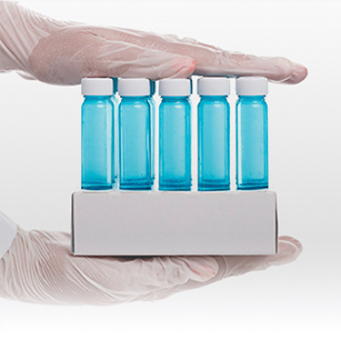 Two hands holding molecular consumables products