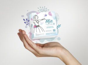 Mia product against a white background floating in someone's hand